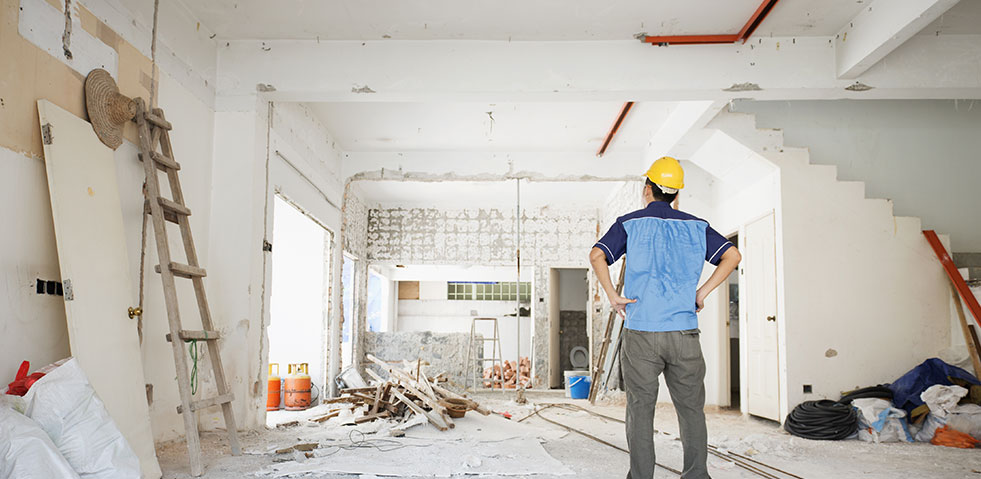 construction worker indoors looking at room
